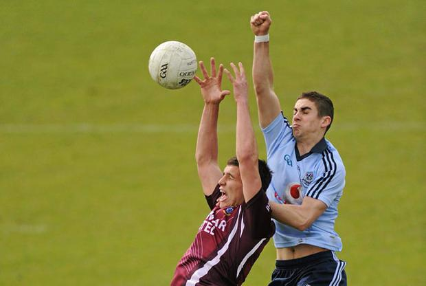 Westmeath's Denis Corcoran is challenged by Dublin's James McCarthy during yesterday's Leinster U21 football Final at Parnell Park. SPORTSFILE