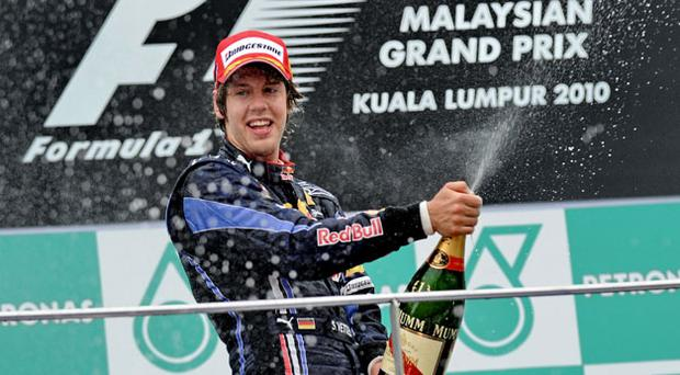 Red Bull's Sebastian Vettel on the podium. Photo: Getty Images