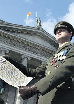 Captain Eoghan O'Sullivan reading the Proclamation outside the GPO on O'Connell Street in Dublin yesterday