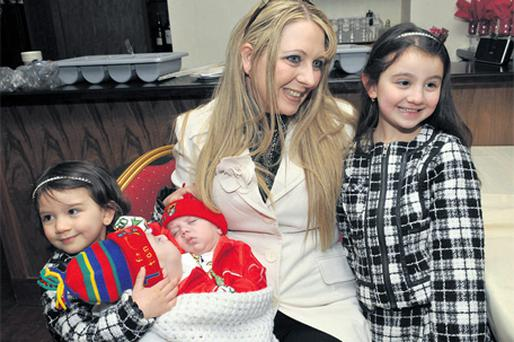 Twins Hassan and Hussein are photographed with mum Angie Benhaffaf and their sisters, Iman and Malika.