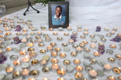 A candlelit tribute to tragic teen Toyosi Shittabey at Hartstown community school in west Dublin yesterday