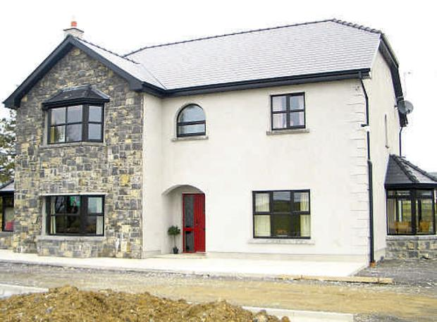 AS ONE: Despite a €235,000 bid for the house, the auctioneer would prefer the farm sold in one lot.