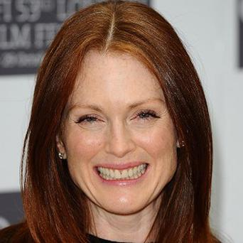 Julianne Moore's children thought she worked in a film set trailer