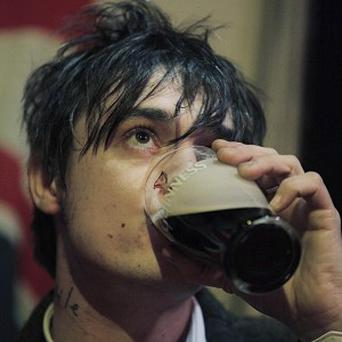Pete Doherty spat beer on a reporter during a live TV interview