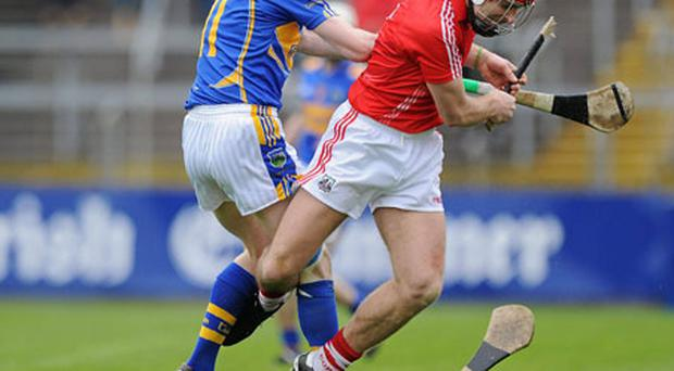 Ronan Curran has his hurl broken during a challenge by Tipperary''s Lar Corbett during Cork's National Hurling League victory in Pairc Ui Chaoimh on Sunday MATT BROWNE/SPORTSFILE