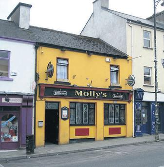 Mollys Bar, Barrack Street, Ballaghaderreen, Co Roscommon, which will be auctioned by REA on April 30. The pub generated a turnover of €489,792 including VAT last year and agent Carthy REA is quoting a €550,000 AMV.