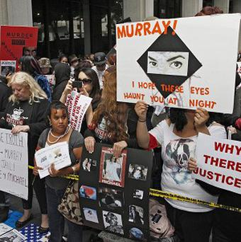 Michael Jackson fans gather outside the Los Angeles Criminal Court