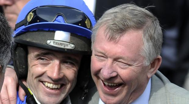 Manchester United manager Alex Ferguson congratulates Ruby Walsh after What A Friend won at Aintree in 2010 Photo: Getty images