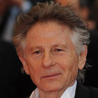 Roman Polanski's lawyers have said the director is facing mounting debts