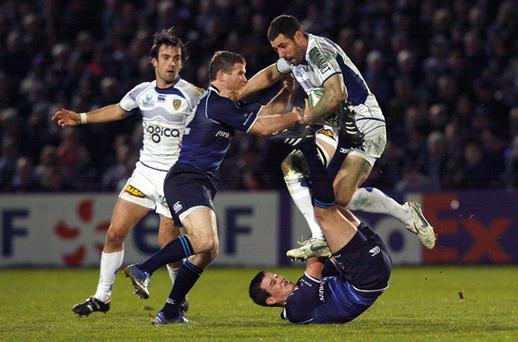 Clermont's Julien Malzieu goes over the top of Jonny Sexton. Photo: Getty Images