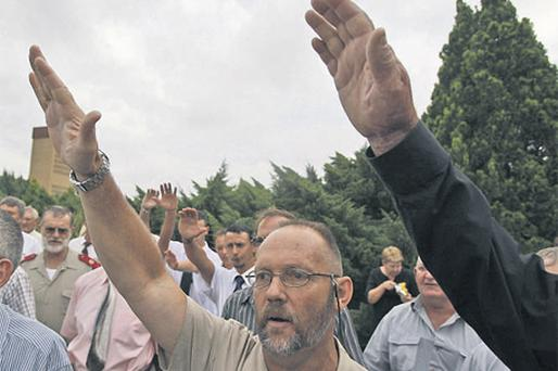 Supporters of white supremacist leader Eugene Terreblanche, outside the church in Ventersdorp, South Africa, yesterday, before his funeral