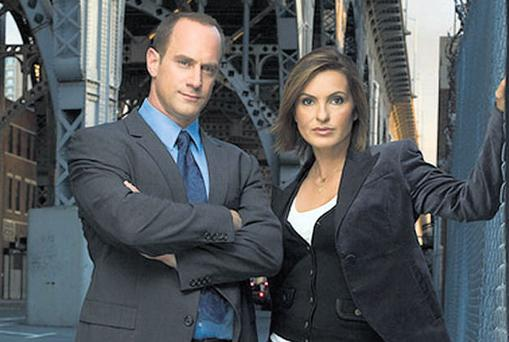 MEAN STREETS: Edward Conlon's book is a gritty account of the activities of New York police, who spend their lives in a highrisk yet low-paid job. Pictured are Christopher Meloni and Mariska Hargitay in the TV series Law & Order set in New York.