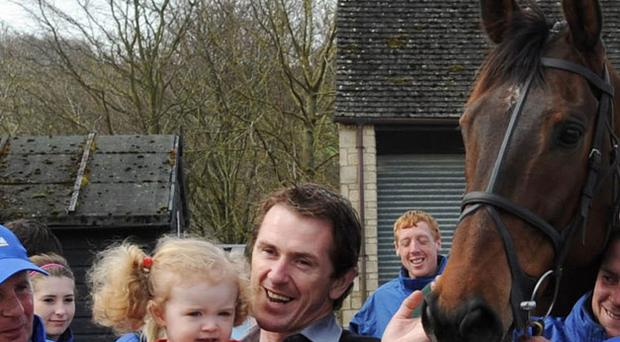 Tony McCoy with his two-year-old daugher Eve and Don't Push It yesterday. Photo: PA