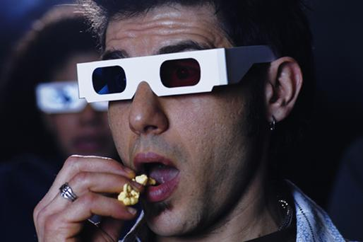 Apple plans to develop electronic spectacles that will allow the wearer to watch 3D films on the move. Photo: Getty Images