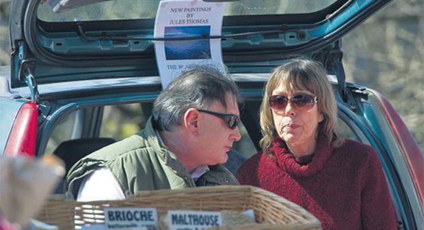Ian Bailey with his partner Jules Thomas at their stall in the farmers' market in Schull, Co Cork, yesterday
