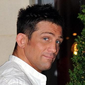 Alex Reid leaves the Soho Hotel in London after giving press interviews.