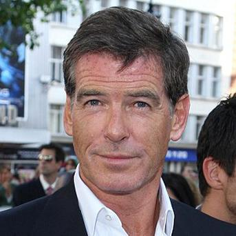 Pierce Brosnan said there are parallels between the film and Polanski's predicament