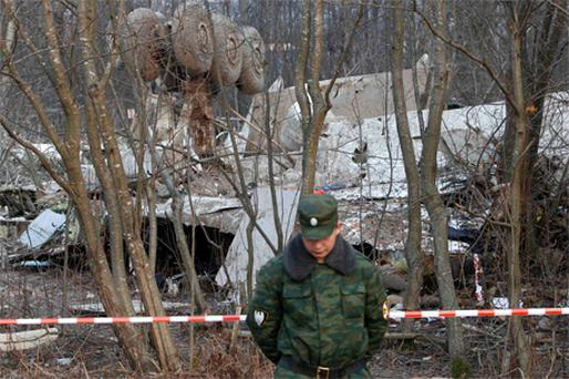 A Russian soldier guards the wreck of the Polish government airplane that crashed near Smolensk on Saturday