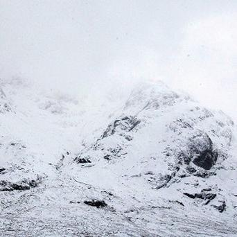 A walker caught in an avalanche was rescued after he made a phone call