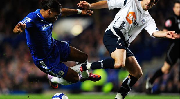 Bolton Wanderers' Sam Ricketts (right) challenges Chelsea's Didier Drogba during their Premier League game at Stamford Bridge last night. Photo: Getty Images