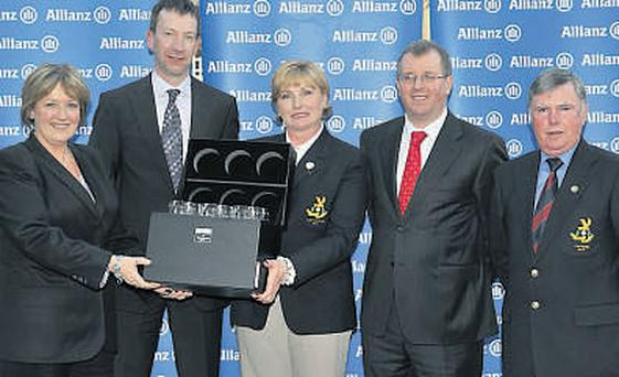 Nuala Fagan (Lady Captain), centre, and John Hicks (Captain), right, of the winning Slade Valley team are presented with their award by, from left, Moira Cassidy (golf director of Portmarnock Hotel and Golf Links); Anthony Shannon (Allianz) and Liam Kelly (Golf Editor, Irish Independent).
