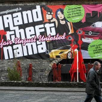 A billboard comparing the National Asset Management Agency (NAMA) to the computer game Grand Theft Auto