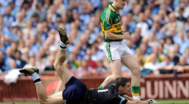 Colm Cooper scores an early goal past Dublin' keeper Stephen Cluxton as the Leinster champions were sent crashing out of the All Ireland Championship despite only one defeat during the summer campaign in 2009.