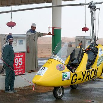 Gyrocopter pilot Norman Surplus had to land at a remote filling station in the desert
