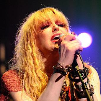 Courtney Love is producing a movie about her late husband