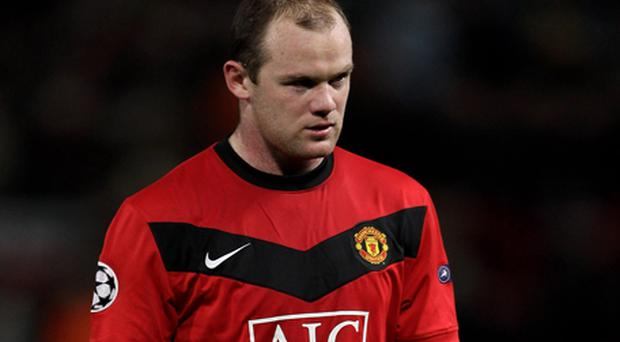 Staying put: Wayne Rooney will not be sold to Real Madrid this summer, Alex Ferguson has confirmed. Photo: Getty Images