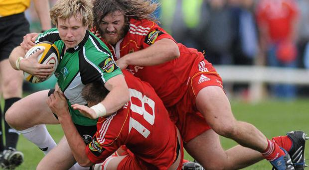 Connacht's Fionn Carr is tackled by Munster duo Dave Foley and Dave Ryan at the Sportsground yesterday. RAY RYAN / SPORTSFILE