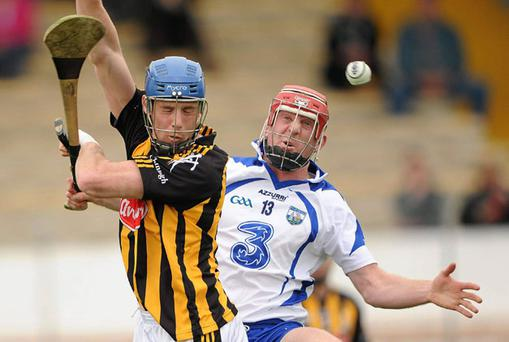 Kilkenny's Brian Hogan and John Mullane battle for possession during the National Hurling League clash in Nowlan Park yesterday. BRENDAN MORAN/SPORTSFILE