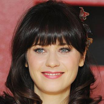 Zooey Deschanel likes to keep her acting and singing separate