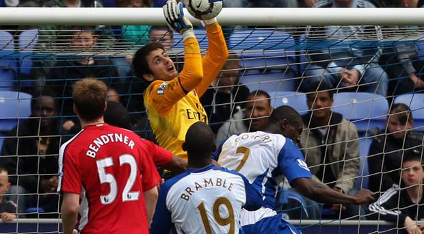 Lukasz Fabianski drops the ball on to Titus Bramble's head for Wigan's equaliser. Photo: Getty Images