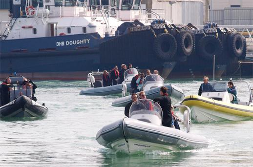 Some stranded travellers evacuated from Calais in France arrive at Dover marina yesterday after a Dunkirk-style rescue. Photo: Max Nash/PA