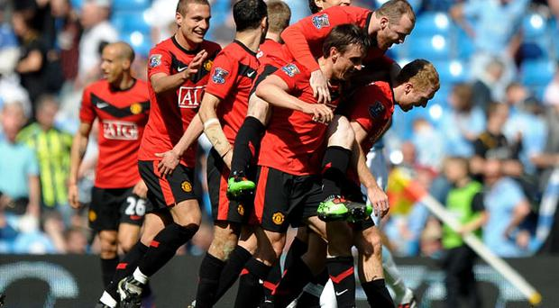 Man of the moment: Paul Scholes (far right) is mobbed by his ecstatic Manchester United team-mates Photo: Getty Images