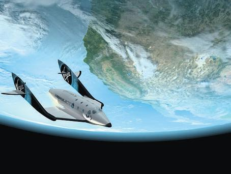 High flyer: The Virgin Galactic VSS Enterprise will be taking passengers into space by the end of 2011
