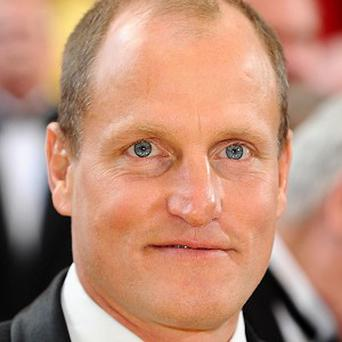 A lawsuit filed by a photographer who accused Woody Harrelson of attacking him has been dismissed