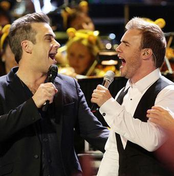 Gary Barlow says Robbie Williams will perform with Take That again