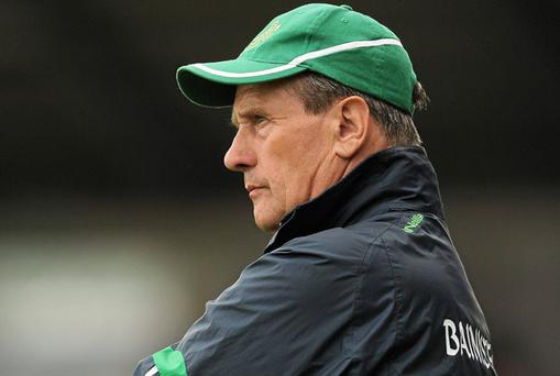 Limerick sponsor JP McManus has given his backing to embattled hurling boss Justin McCarthy.
