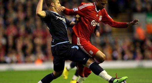 West Ham United's Manuel da Costa challenges Liverpool's David Ngog during the home side's victory at Anfield last night. Photo: Getty Images