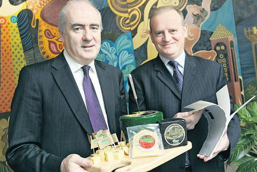 TASTY READ: Chairman Michael Cronin and CEO Kevin Lane taste some cheeses at the launch of the Irish Dairy Board's 2009 results.