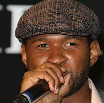 Usher has hit the top of the British singles chart