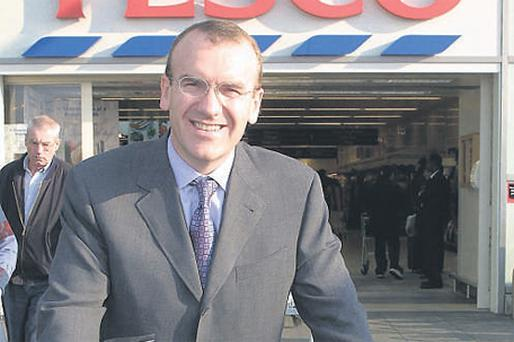 Tesco Plc chief executive Terry Leahy pushes a shopping cart of profits