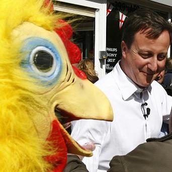 Conservative Party leader David Cameron with a man dressed as a chicken