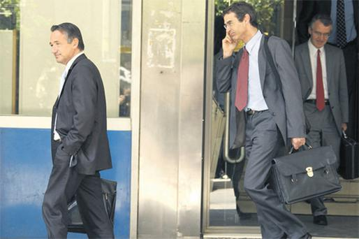 International Monetary Fund and European Union officials leaving Greece's finance ministry in Athens yesterday as the country started talks with officials from both institutions to hammer out details of an economic plan that could offer the eurozone member €40-45bn to exit its debt crisis