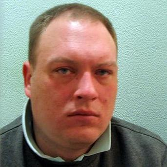 Peter Mahoney, a violent thug responsible for a terrifying car-jacking at gunpoint, who was jailed thanks to crucial DNA from his pet dog