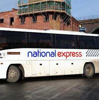 A National Express bus driver is facing dismissal after he was filmed apparently reading a book at the wheel