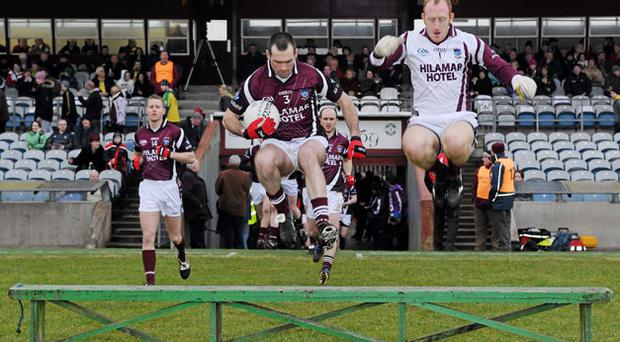 Westmeath's Michael Ennis and Gary Connaughton jump over the bench for the team photograph before their Division Two game against Donegal. PAUL MOHAN / SPORTSFILE