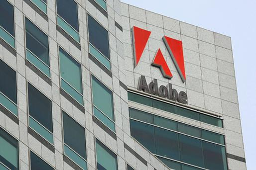 A senior Adobe executive said the company would focus on rival mobile platforms to Apple's iPhone. Photo: Getty Images